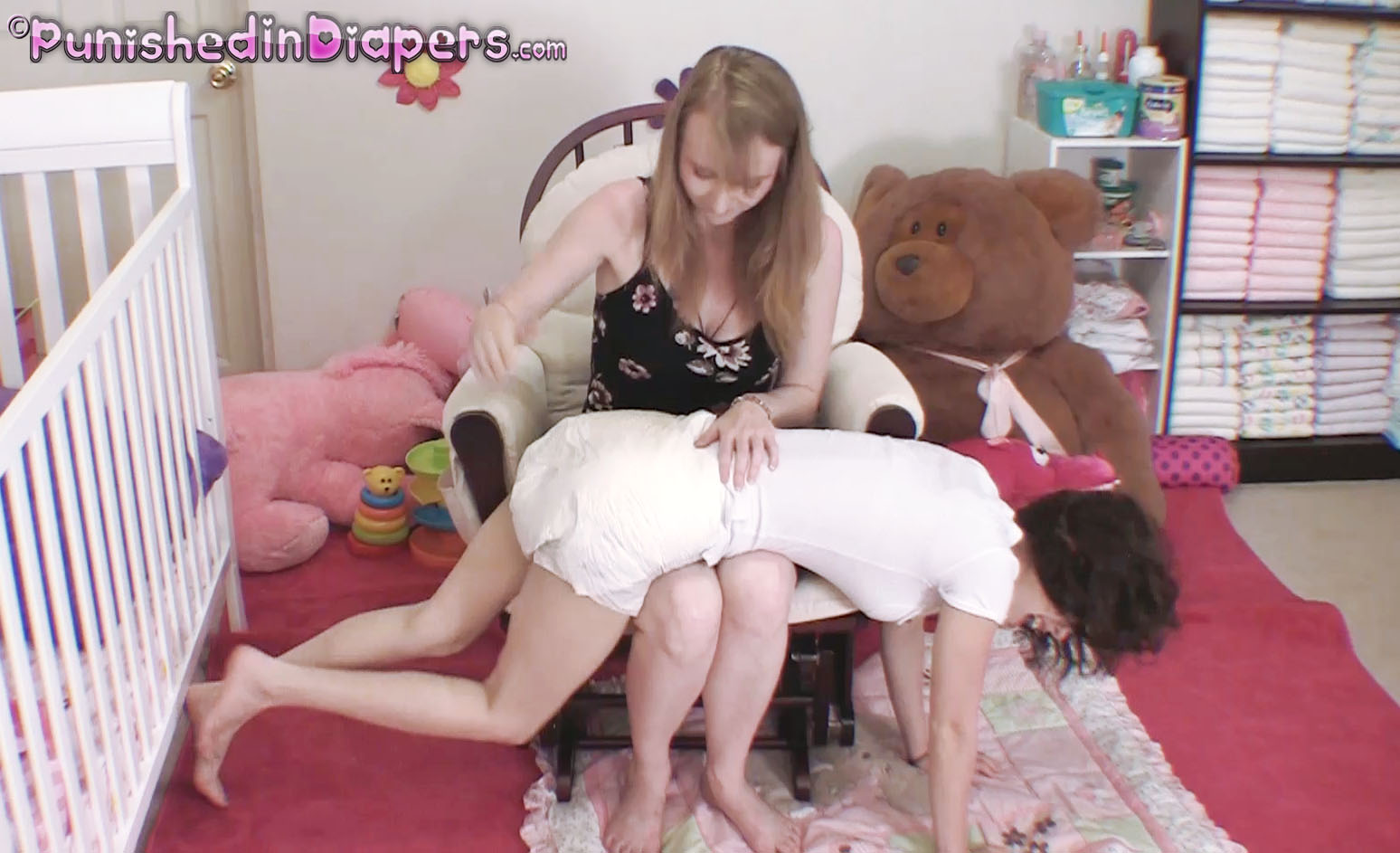 Spanked diaper changed over knee mom
